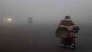 Cyclists ride on a road in heavy smog in Hefei city, east Chinas Anhui province, 14 January 2013.  For the fourth straight day, health authorities in multiple Chinese cities advised residents to stay indoors Monday (14 January 2013), as a blanket of smog continued to choke much of China after recording beyond index levels last weekend at air quality monitoring stations in Beijing. The capital and 32 other cities suffered hazardous air last weekend, local media reported, swelling hospitals with patients reporting respiratory and heart problems. Face masks sold quickly at pharmacies, and some airports and highways suffered delays and closures amid greatly reduced visibility. But the governments increased disclosure of pollution data, and the state medias blanket coverage of the crisis, encouraged some Chinese environmentalists to see a silver lining amid the clouds darkening the worlds largest emitter of greenhouse gases, where the priority of fast economic growth routinely swamps environmental concerns.