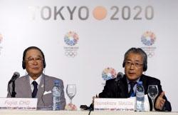 ブエノスアイレスで開いた会見では汚染水問題に質問が集中。東京五輪招致委の竹田恒和理事長(右)と日本体協の張富士夫会長(4日)=ロイター