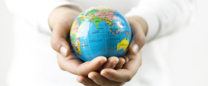 donation-KID-HANDS-HOLDING-GLOBE-large570